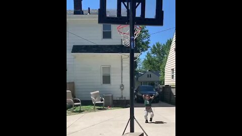 3-year-old picks up a basketball and makes a shot with ease