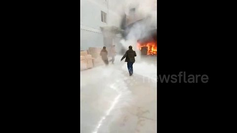 Worker cheats death after walking into ablaze factory to retrieve phone