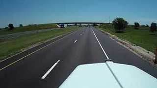 Truck Dash Cam Captures Scary Moment When Shed Flies Across Highway