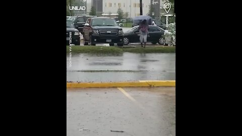 Woman Walks Through Car Park And Falls In Puddle