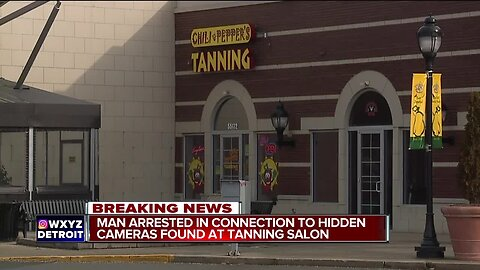 Man arrested in connection to hidden cameras found at tanning salon