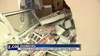 Vehicle slams in to Dearborn dentist office waiting room - Video