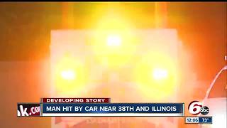 Man walking in road struck by vehicle on Indy's north side - Video