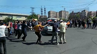 Protesters Block Roads and Dance on Streets of Armenian Capital