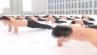 Shirtless Chinese soldiers train in snow - Video