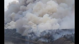 Firefighters Battle McMurray Fire by Helicopters - Video