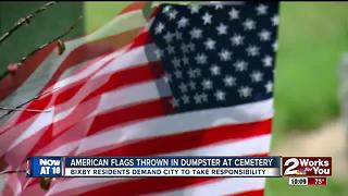 American flags thrown in dumpster - Video