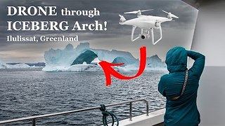 Photographer Flies Drone Through Arched Iceberg in Greenland - Video