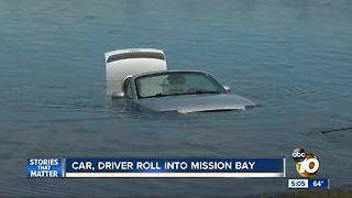 Car, driver roll into Mission Bay - Video