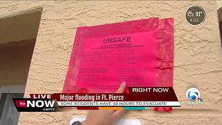 Residents must evacuate flooded apartments in Fort Pierce - Video