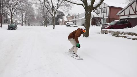 Snowboarding throughout the city of Toronto