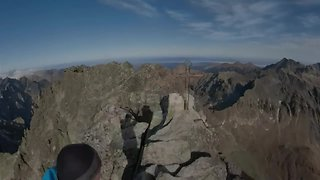 Fearless Daredevil Scales Narrow Mountain Cliff To Reach Summit - Video