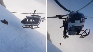 Skillful Helicopter Pilots Almost Touches Mountainside With Rotor Blades In Breathtaking Rescue