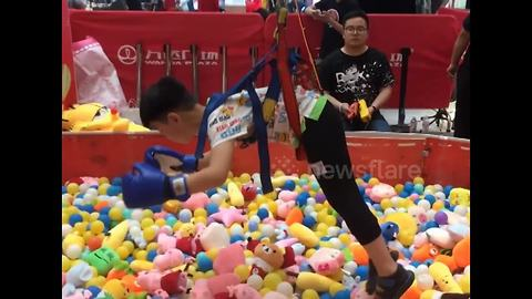 Now children in China can become human claw machines at the local mall