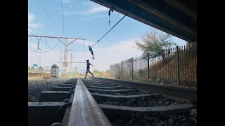 Young boys playing with railway cables