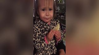 Tot Girl Bites A Slice Of Lemon - Video