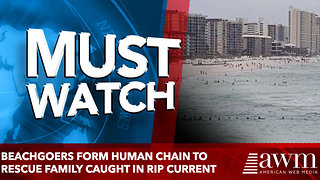 Beachgoers Form Human Chain To Rescue Family Caught In Rip Current - Video