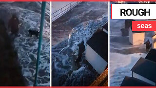 Terrifying moment dog walker gets smashed by huge waves crashing over sea wall in storm