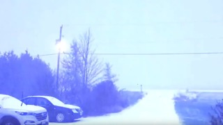Lightning Strikes in Ontario Night as First Snow of Season Falls - Video