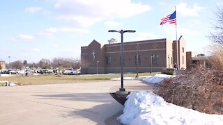 Lansing Catholic High School fires employee for posting controversial photo on school's social media accounts