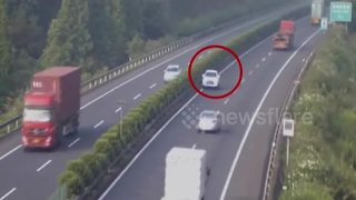 CCTV captures car travelling wrong way down China motorway - Video