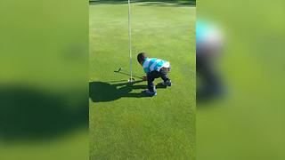Little Boy Cheats While Playing Golf