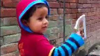 Cute boy kept book in hand & walking talking with his Uncle  - Video