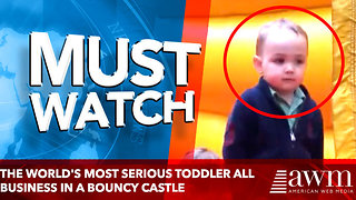 The world's most serious toddler keeps things professional in a bouncy castle - Video