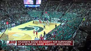 Students show solidarity for survivors at Spartan game against Wisconsin - Video