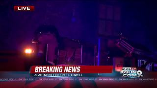 Firefighters working midtown apartment fire - Video
