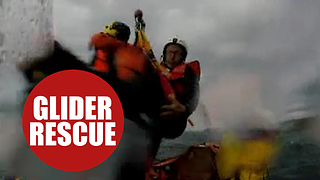 Paraglider being rescued from the sea by RNLI after inflight failure