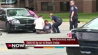 Child on bike hit by car at Dream Cruise - Video