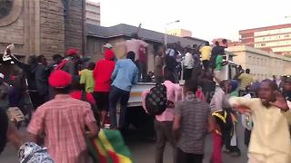 Celebrations erupt outside parliament after Mugabe resigns - Video