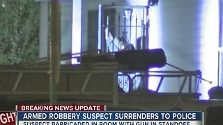 Suspect identified from overnight armed robbery standoff - Video