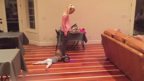 A Young Girl Rides A Hoverboard And Drags Her Tot Sister Around A Room