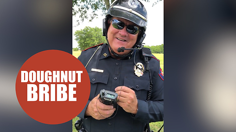 Hilarious footage shows a policeman being bribed with a doughnut