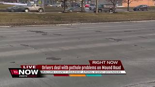 Drivers dealing with pothole problem on Mound Road - Video
