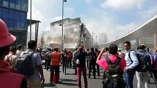 Bystanders Gather Around Collapsed Shopping Mall in Mexico City - Video