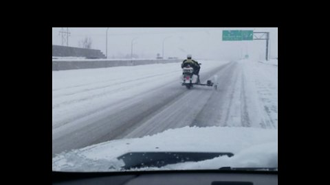 'Cruisin' Like it's No Big Deal': Motorcyclist Rides Through Snowstorm in Minnesota
