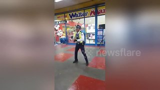 Security guard shows off dance moves outside supermarket