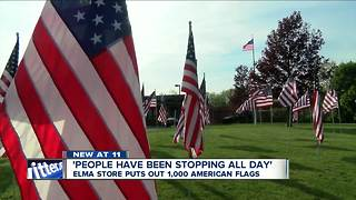 Elma store puts out 1,000 American flags - Video