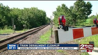 Crews cleaning up after yesterday's train derailment - Video