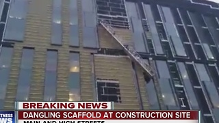 Two people rescued after dangling at construction site - Video