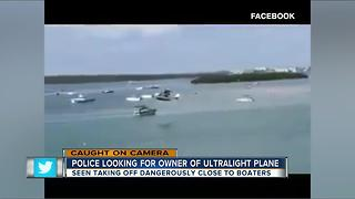 CAUGHT ON CAMERA: Small plane illegally flies dangerously close to boats at busy tourist attraction - Video