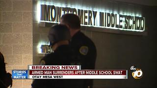 Armed man surrenders after middle school standoff - Video