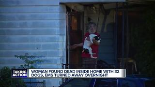 Woman found dead in home with dogs