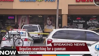 Police search for gunman near shopping plaza in suburban Boca Raton - Video