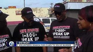 Volunteers search for clues to solve murder - Video