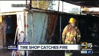 Firefighters contain fire at Phoenix tire shop - Video