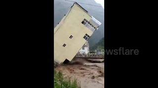 Five-storey building collapses due to flooding - Video